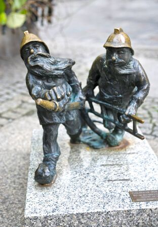 Poland, Wroclaw, September 17, 2015: The bronze gnomes became the symbol of Wroclaw and one of the famous landmarks of the city in Poland. There are maps for searching the city Editorial