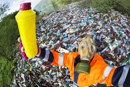 Pollution of household waste of clean mountain rivers in the Carpathians Ukraine is a huge problem for people. Special workers collect garbage, as a symbol of saving the planet Earth Stock Photo