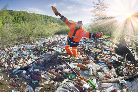 Pollution of household waste of clean mountain rivers in the Carpathians Ukraine is a huge problem for people. Special workers collect garbage, as a symbol of saving the planet Earth Banco de Imagens