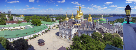 Aerial perspective of a panoramic view of the famous bell tower of the Kiev-Pechersk Lavra in the spring Kiev, temples Cathedral. Blooming chestnut foliage decorates the capital 写真素材 - 102745785