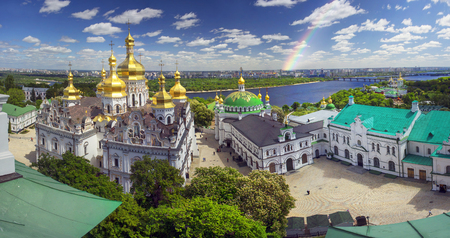 Aerial perspective of a panoramic view of the famous bell tower of the Kiev-Pechersk Lavra in the spring Kiev, temples Cathedral. Blooming chestnut foliage decorates the capital