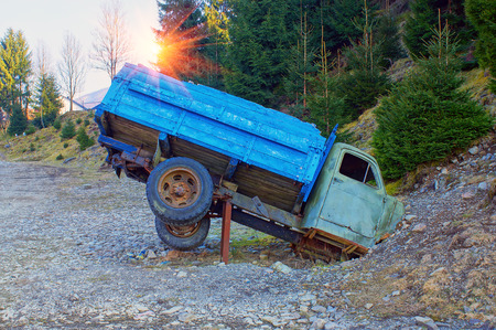 Monument in the mountains of the Ukrainian Carpathians is dedicated to the broken Soviet truck on a background of forest and mountains. It attracts tourists to the museum railway