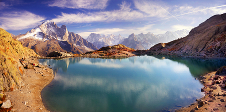 Mont Blanc Chamonix France autumn - picturesque lakes are fantastically beautiful after the first frost against the background of the steep peaks of the Alps with glaciers and rocks Reklamní fotografie