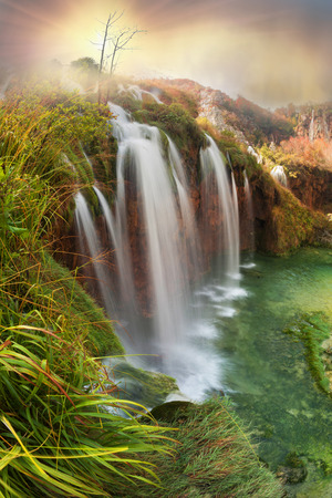 Plitvice Waterfalls in Croatia is one of the famous famous places in Europe, very beautiful. The jets of water on the background of autumn forests at sunrise are very picturesque Stock Photo