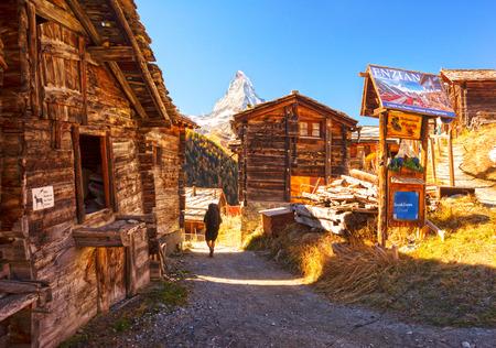 Switzerland, Zermatt, October 20, 2018: Autumn resort slopes and bright beautiful landscape with the famous Matterhorn peak in autumn in Switzerland. Original beautiful houses