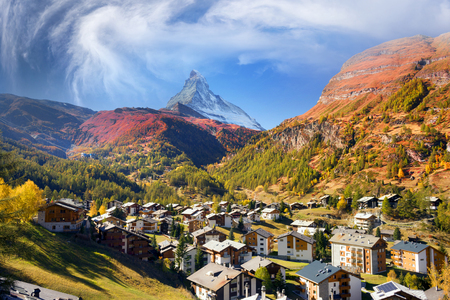 Autumn resort slopes and bright beautiful landscape with the famous Matterhorn peak in autumn in Switzerland. Original beautiful houses of the Swiss highlanders