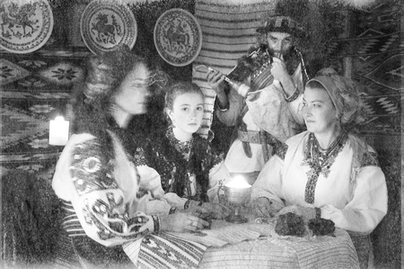 Ukrainians Hutsuls in the Carpathians in traditional ancient  costumes ornaments, which for more than a hundred years show the life and culture of our ancestors of the Slavs of Ukraine. old photo Foto de archivo