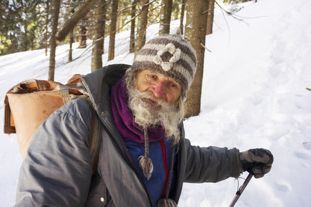 In winter, an interesting original traveler lives in the Carpathians-a very old, almost a hundred-year-old grandfather, who in his youth ascended to many complex peaks