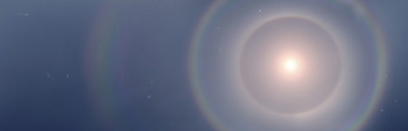 Halo usually appears around the sun and moon. They are caused mainly by ice crystals in cirrus clouds at a height of 5-10 km in the upper troposphere.
