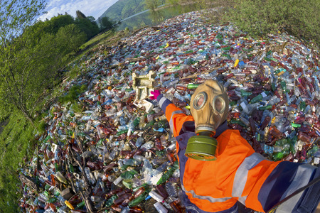 Pollution of household waste of clean mountain rivers in the Carpathians Ukraine is a huge problem for people. Special workers collect garbage, as a symbol of saving the planet Earth Editorial