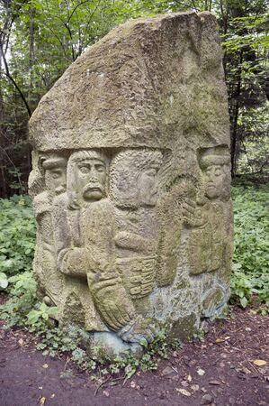 Ancient image of shepherds sheep and lumberjacks. The stone is in the wild forest, Stock Photo