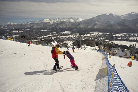 Poland, Zakopane, February 23, 2019:  People happily ski and tourist resort of the Polish city Zakopane in the Tatras