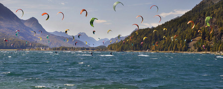 Switzerland, Silvaplana, October 13, 2019: Silvaplanersee, Lej da Silvaplauna is a lake in the Upper-Engadine valley of Grisons, Switzerland. Many athletes use the wind to fly over water. 報道画像