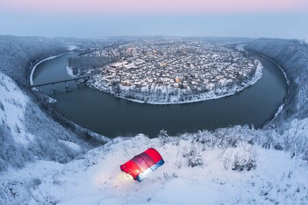 """Zalischiki in Ukraine during the blizzard during the New Year holidays, when a snow storm traced patterns of a huge river meander around an ancient city, called the """"miracle of the world"""""""