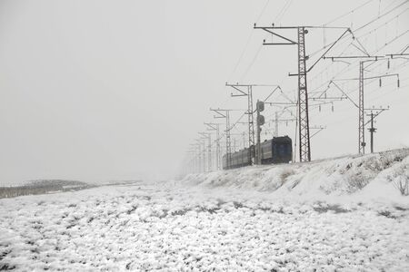 Crimean Ukrainian electric railway in winter through the isthmus near the swamp sea Sivash. Now trains do not run here, because Crimea was occupied by Russia