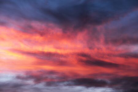 sky glows with the fiery colors of a fabulous sunset - the weather and climate change rapidly with the advent of new atmospheric currents. A wonderful background for decorative advertising.