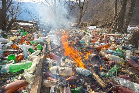Tourist photographed a panorama of ecological disaster - the river carries plastic rubbish to Europe, abandoned by non-cultural populations. plastic fire releases dangerous chemicals Banco de Imagens