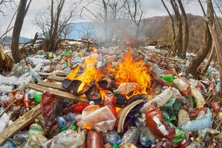 Tourist photographed a panorama of ecological disaster - the river carries plastic rubbish to Europe, abandoned by non-cultural populations. plastic fire releases dangerous chemicals Reklamní fotografie