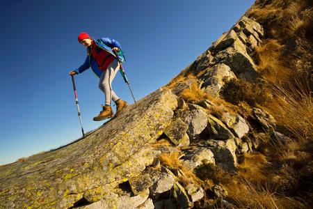 Woman Hiking through the mountains.