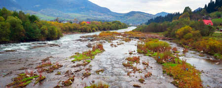 In the Carpathians, on the Borzhava ridge, an ecological disaster. High autumn mountains and rivers covered with plastic debris amaze the traveler