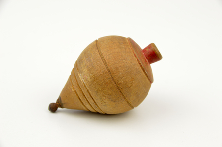 spinning top: Old wooden spinning top on a white background