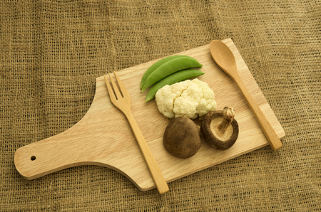shitake: Fresh green peas,cabbage and shitake mushroom on wood cutting board Stock Photo