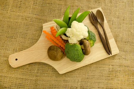 shitake: Fresh shitake mushroom,broccoli and green pea on wooden board Stock Photo
