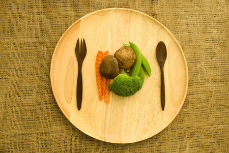 shitake: shitake mushroom,broccoli and green pea on wooden dishware Stock Photo