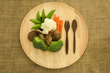 fiber food: broccoli and green pea on wooden dishware, shitake mushroom