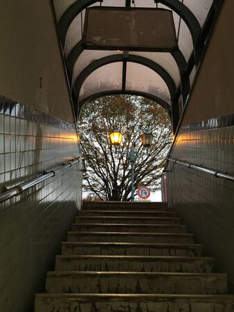 glow: Lamp tower at the end of tunnel