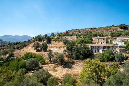 landscape with a view abandoned buildings on Crete Stock Photo