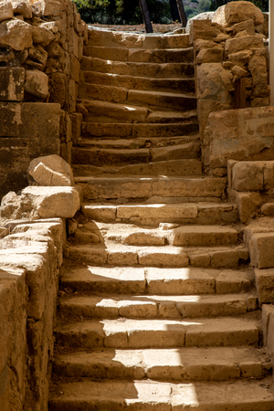 ancient stair with crooked steps at an excavation Stock Photo