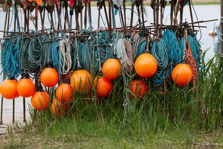 orange buoys with a turquoise fishing net