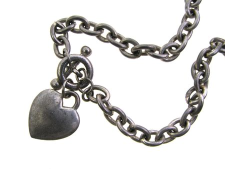 old worn silver heart charm bracelet isolated in white photo