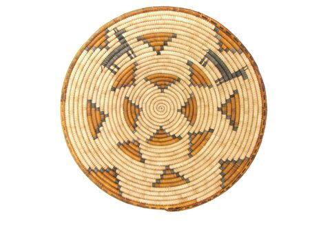 tan, brown, and black coiled African basket with animal figures isolated on white Stock Photo - 3278399