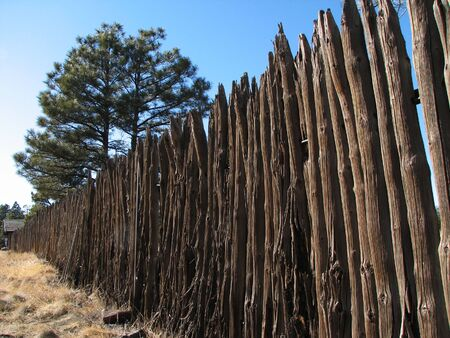 an old weathered wooden picket fence stretches into the distance Stock Photo - 3278408