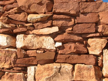 sandstone: dry stacked red sandstone wall background Stock Photo