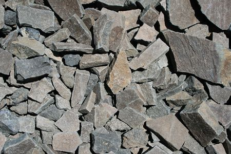 angular: broken gray angular andesite rock background