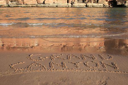 Grand Canyon written in the sand on a Colorado River bank beach Stock Photo - 3284858