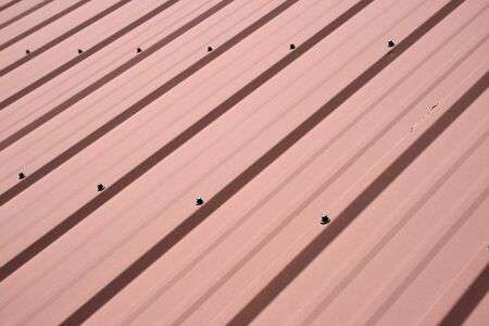 red metal roof background with diagonal panels