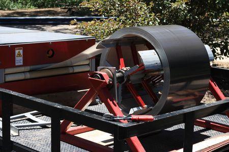 metal sheet: metal enters a machine for folding sheet metal into metal roofing