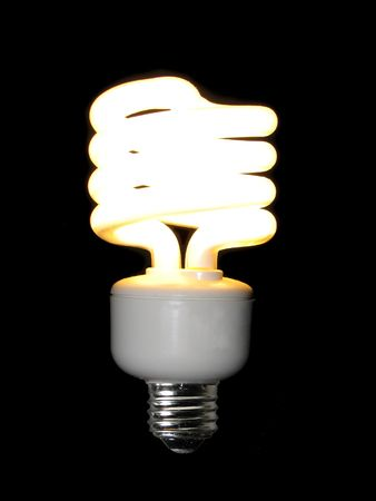 lit compact fluorescent light bulb isolated on black background stock photo - Compact Fluorescent Light Bulbs