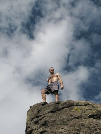 A male climber on the summit top Stock Photo - 3287075