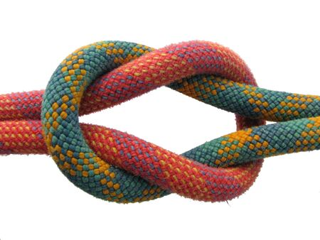 square knot with red and green climbing ropes isolated on white