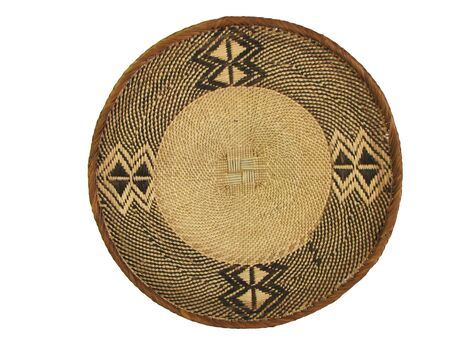 brown and tan woven african basket isolated on white