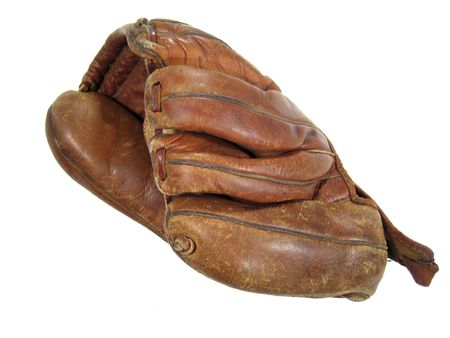 An old baseball mitt (1950s Roy McMillan model) isolated on white photo