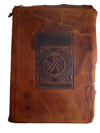 tooled: brown leather book cover with space for title