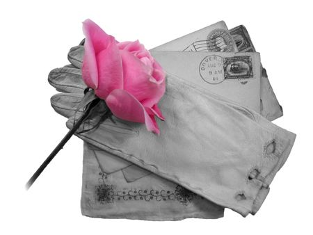 reminisce: A pink rose on old black and white mementos isolated on white