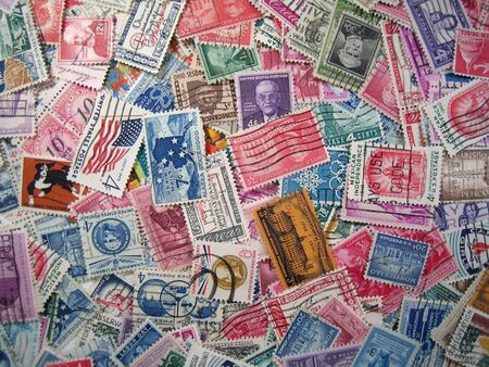 background of many cancelled 1950's postage stamps Фото со стока - 3318435