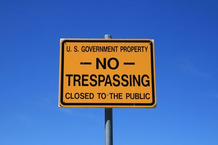 US Government no trespassing sign against a blue sky Stock Photo - 3477400